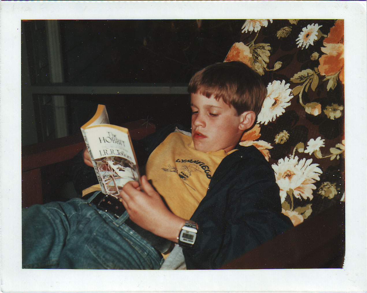 The author, at about age 11, reading The Hobbit